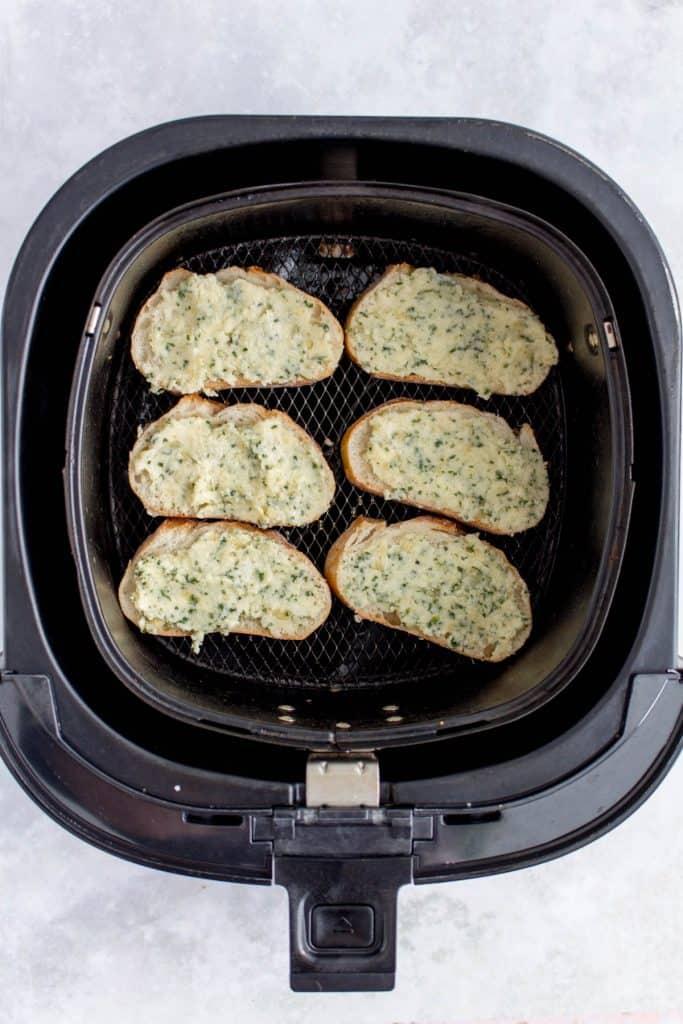 Garlic butter baguette inside of an air fryer.