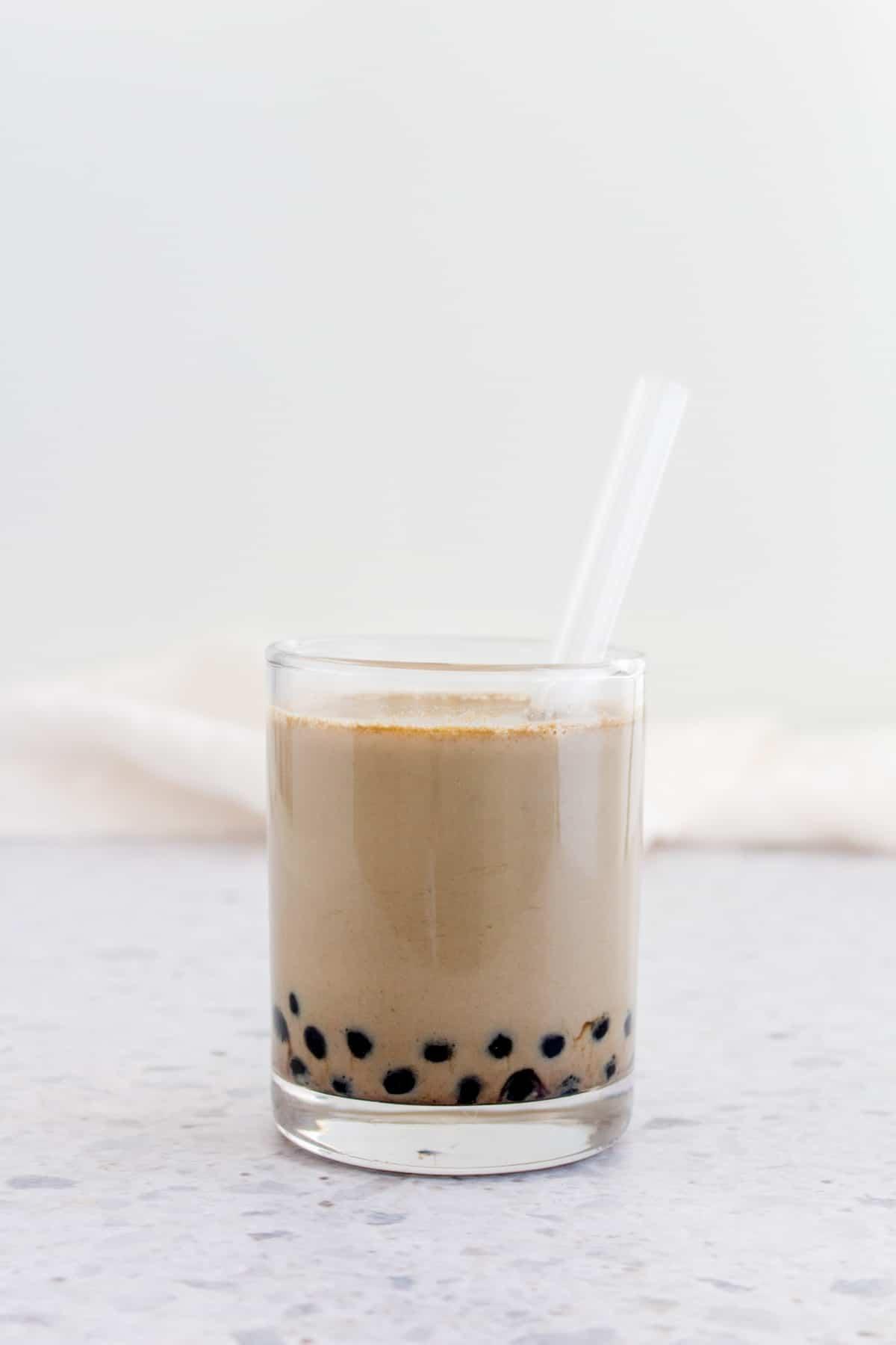 Hojicha boba tea in a cup.