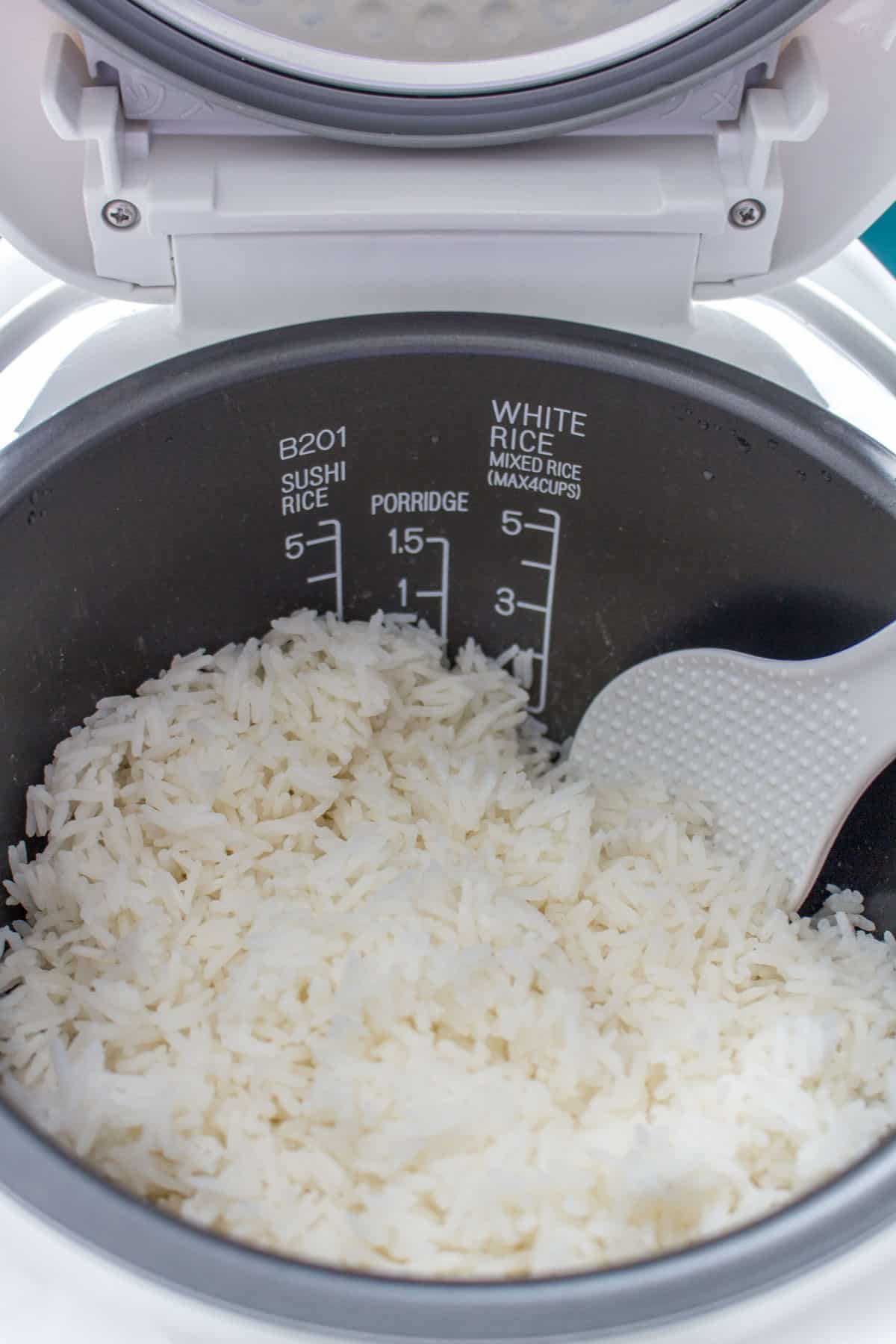 Jasmine rice inside of a rice cooker.