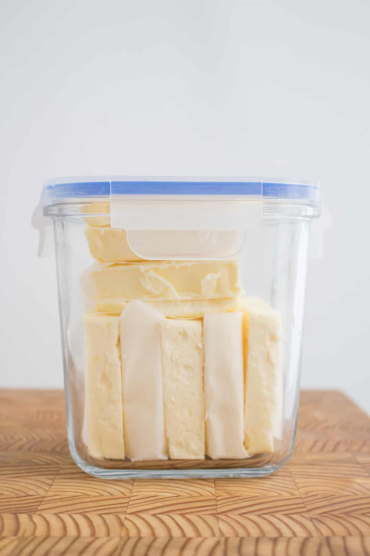 Butter in a container to be frozen.