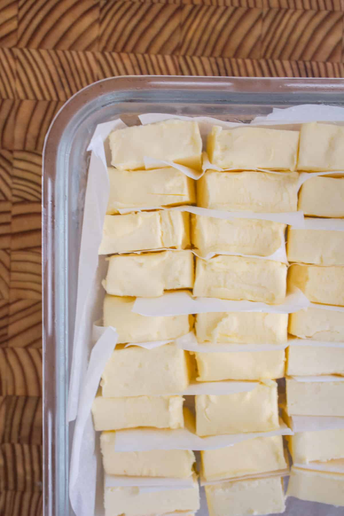 Frozen tablespoons of butter in a glass container.