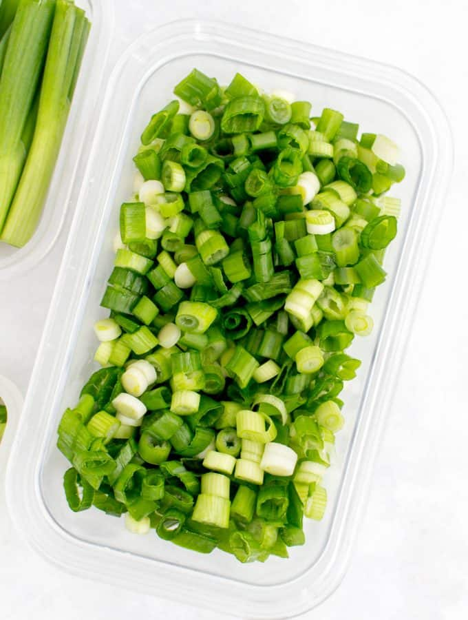 Sliced green onions in a container.
