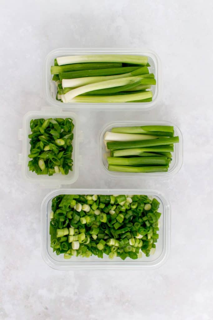 Green onions prepped in freezer containers.