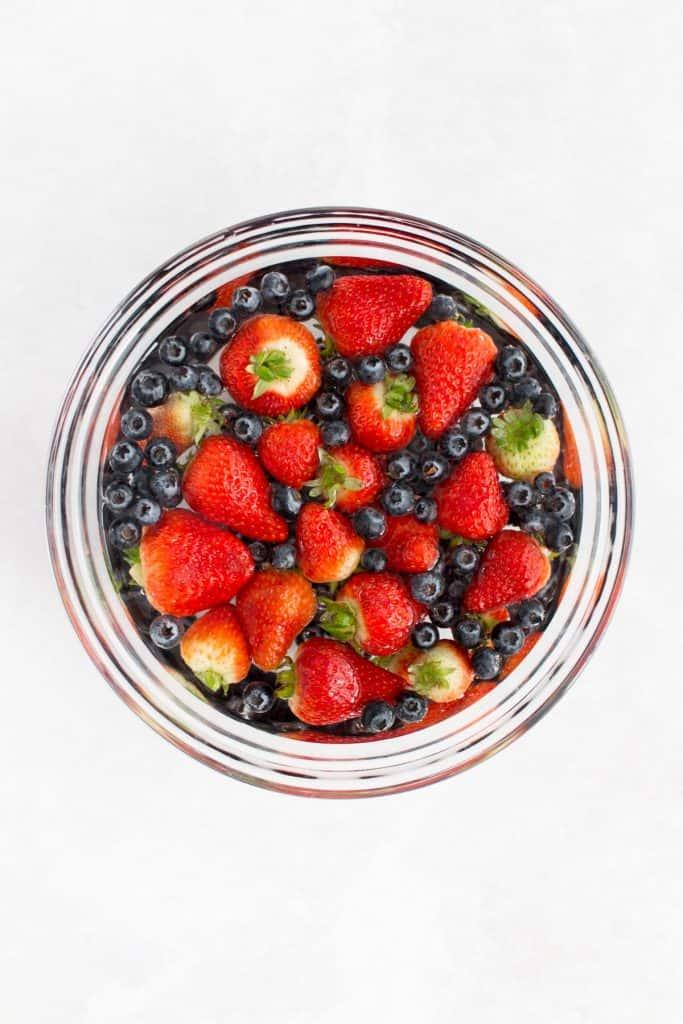 Berries in a vinegar bath.