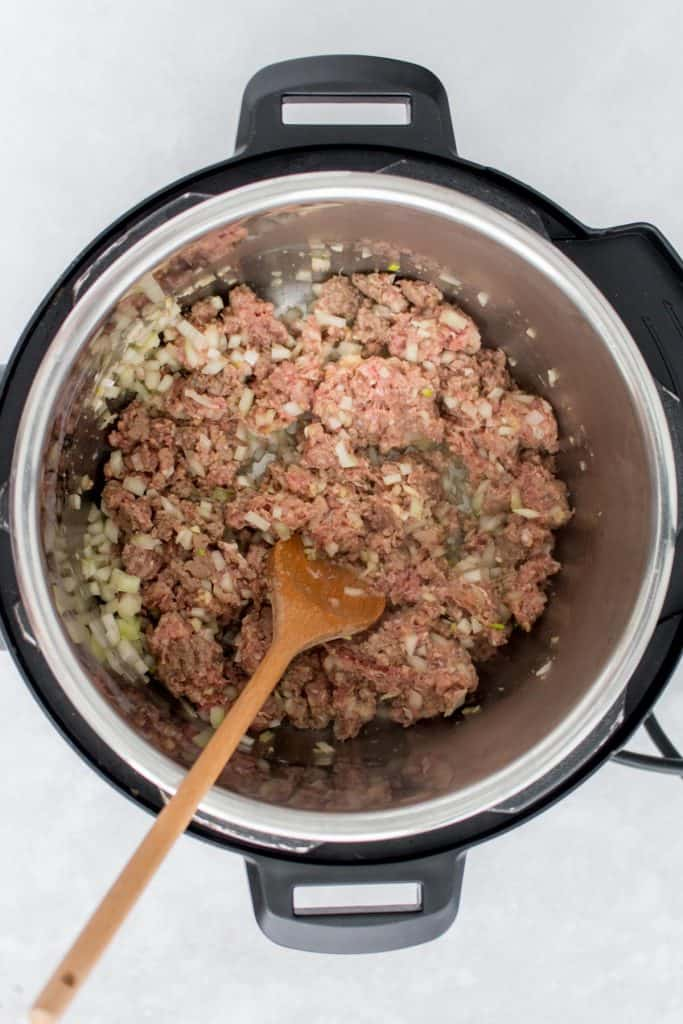 Ground beef, onion, and garlic sautéed in an Instant Pot.
