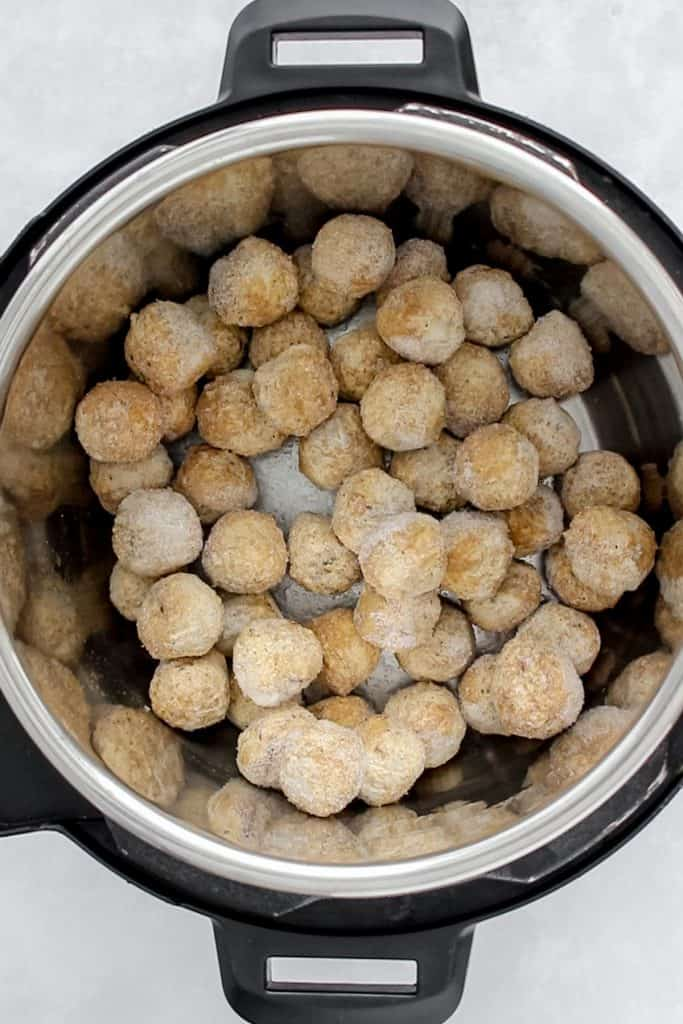 Frozen meatballs inside of an Instant Pot.