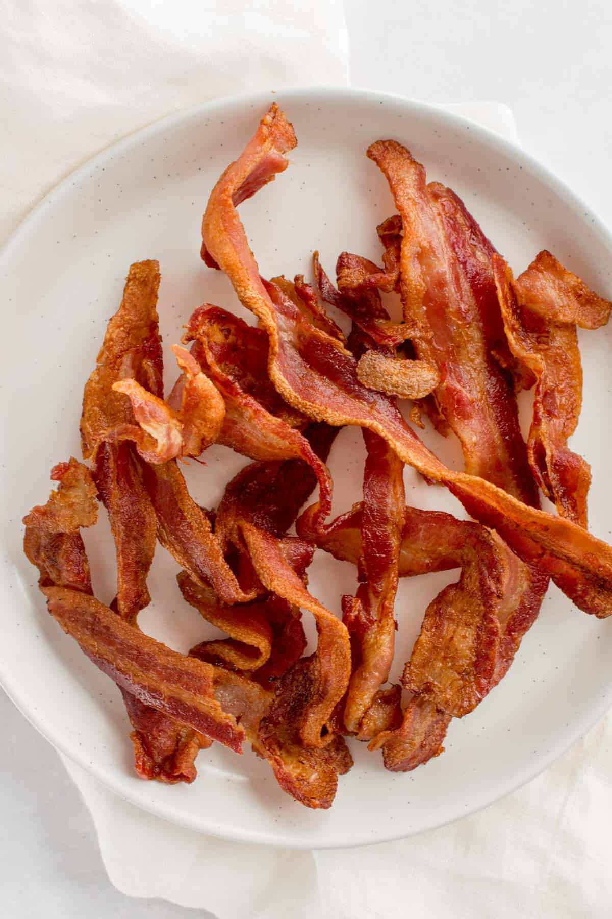 Close up of a plate of bacon made with an air fryer.