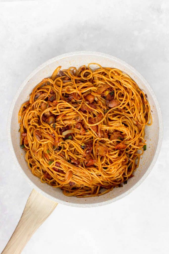 Gochujang noodles with bacon and scallions.
