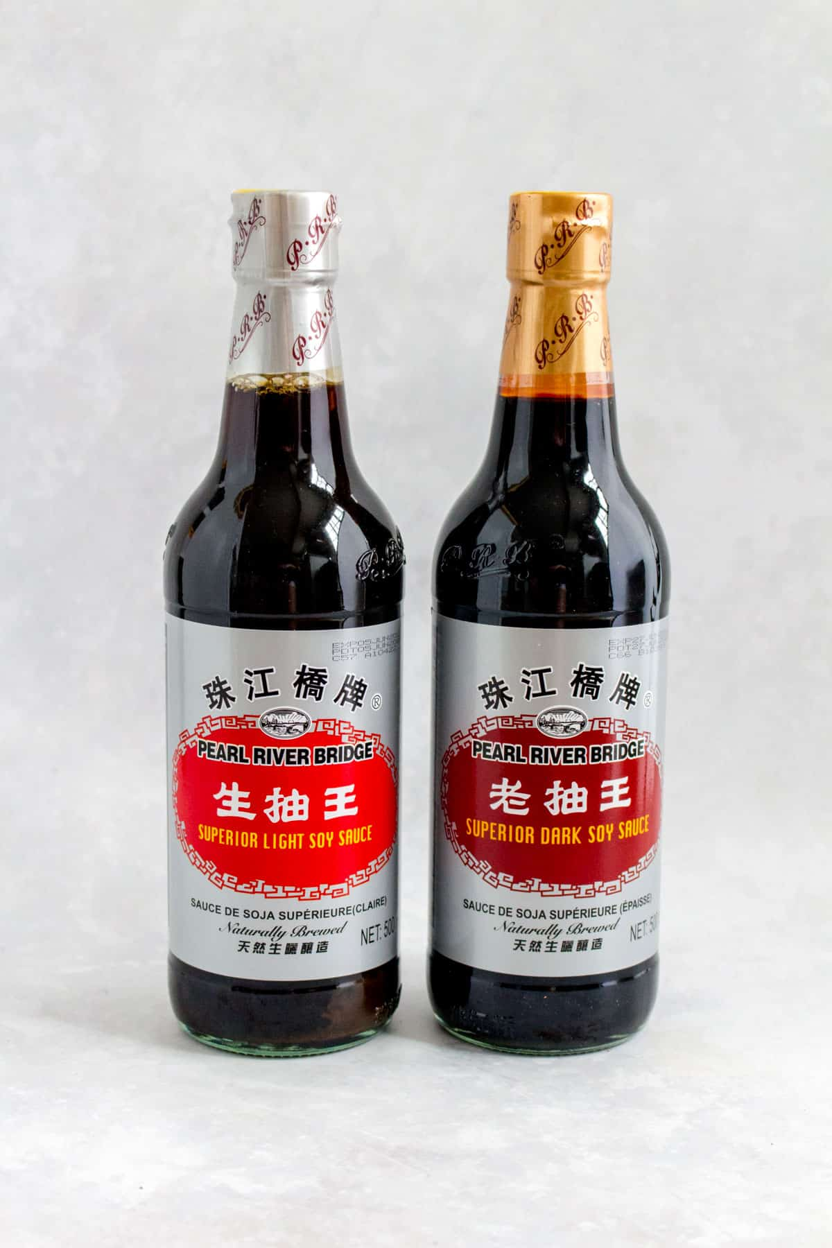 Light soy sauce and dark soy sauce.