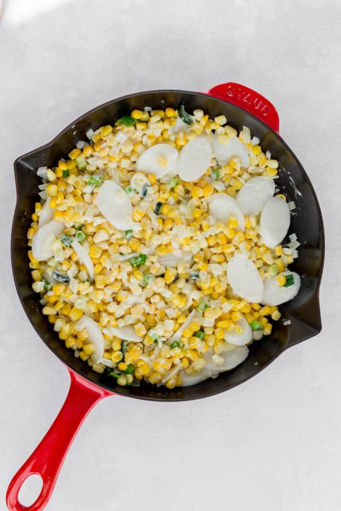 Mixed corn in a cast iron skillet.