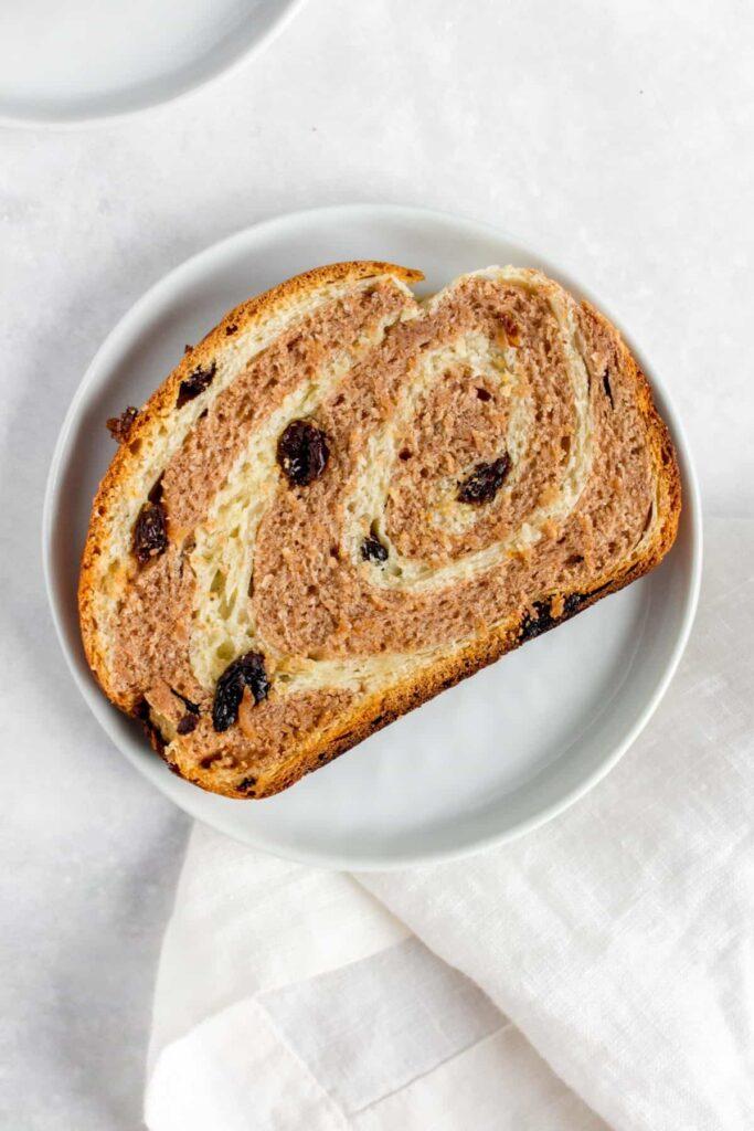 Close up of a plate of cinnamon raisin bread.