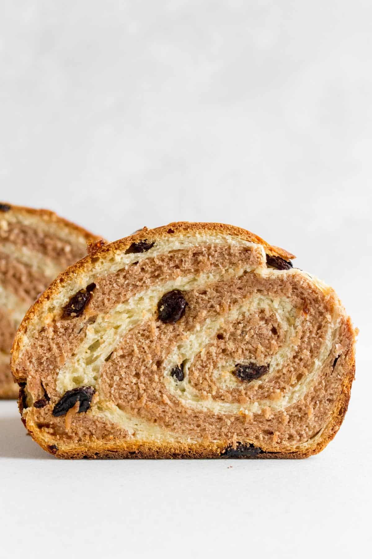 Cinnamon raisin swirl bread cut in half.