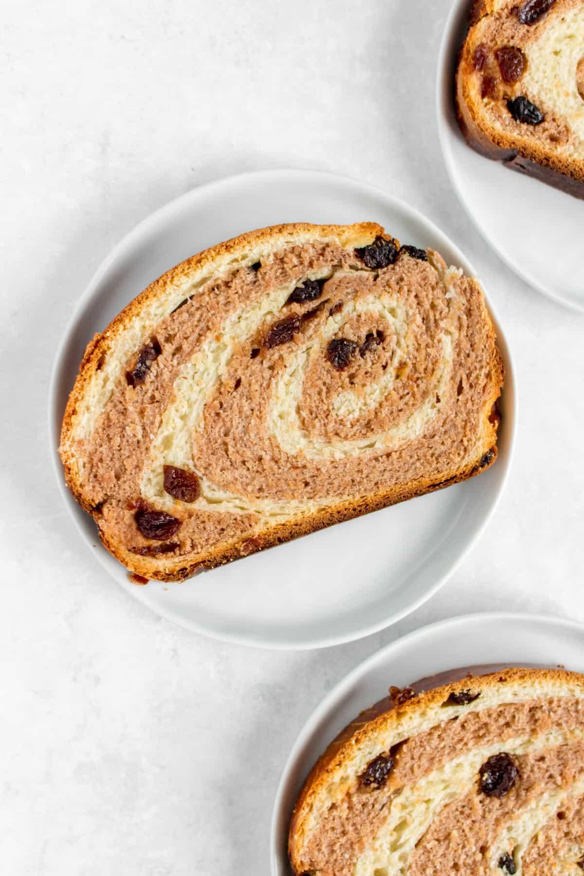 Slice of cinnamon raisin milk bread in a plate.