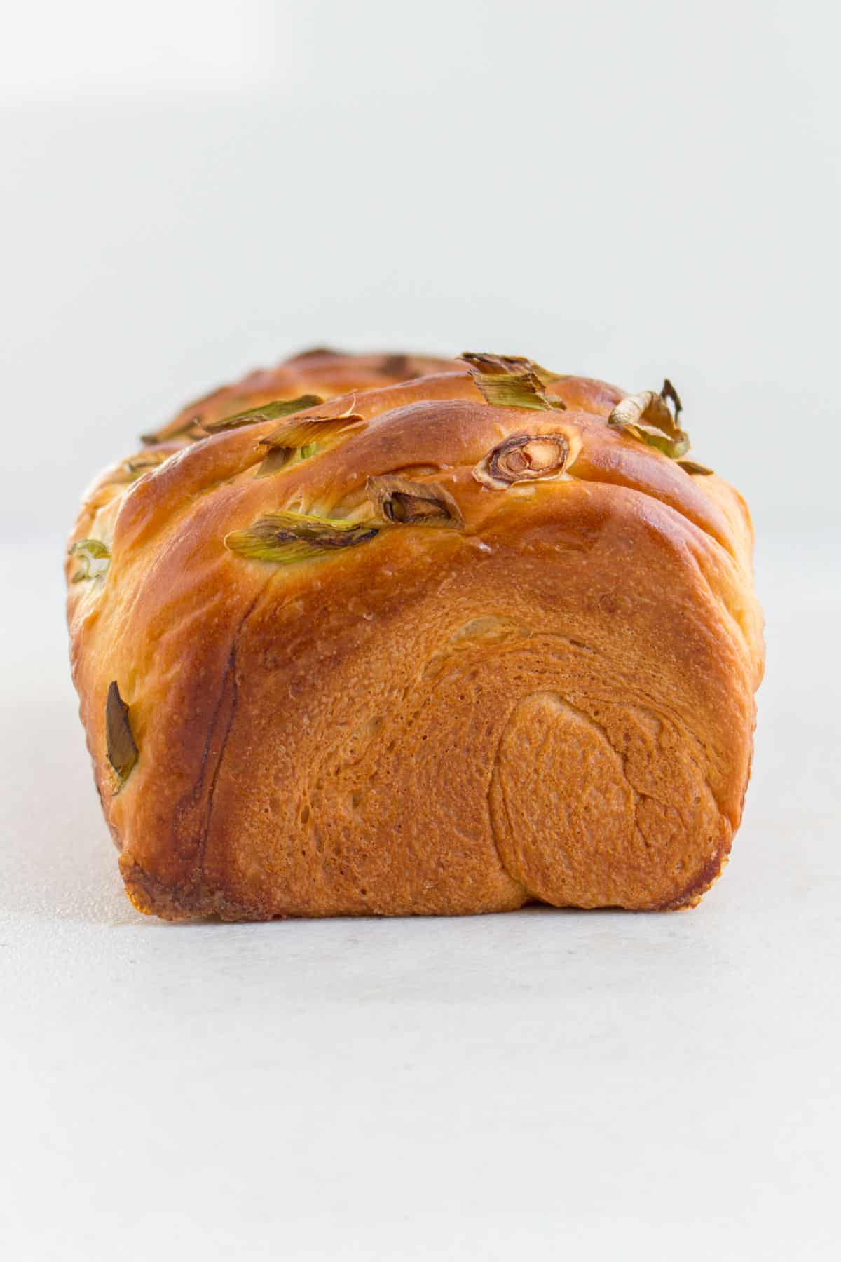Profile view of a loaf of milk bread.