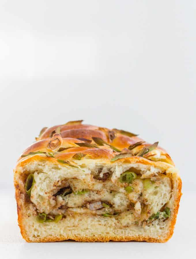 The inside of the scallion milk bread showing the swirls.