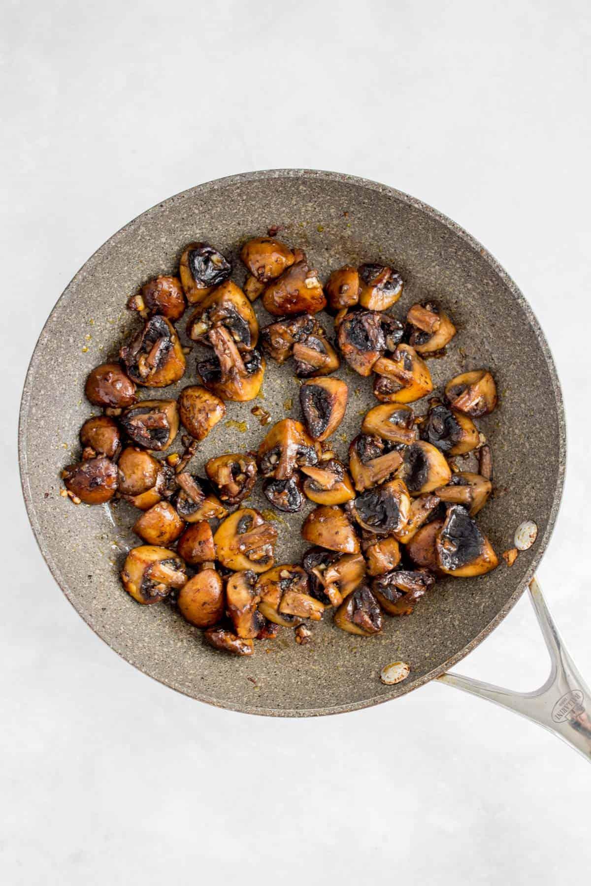 Garlic mushrooms in a pan.