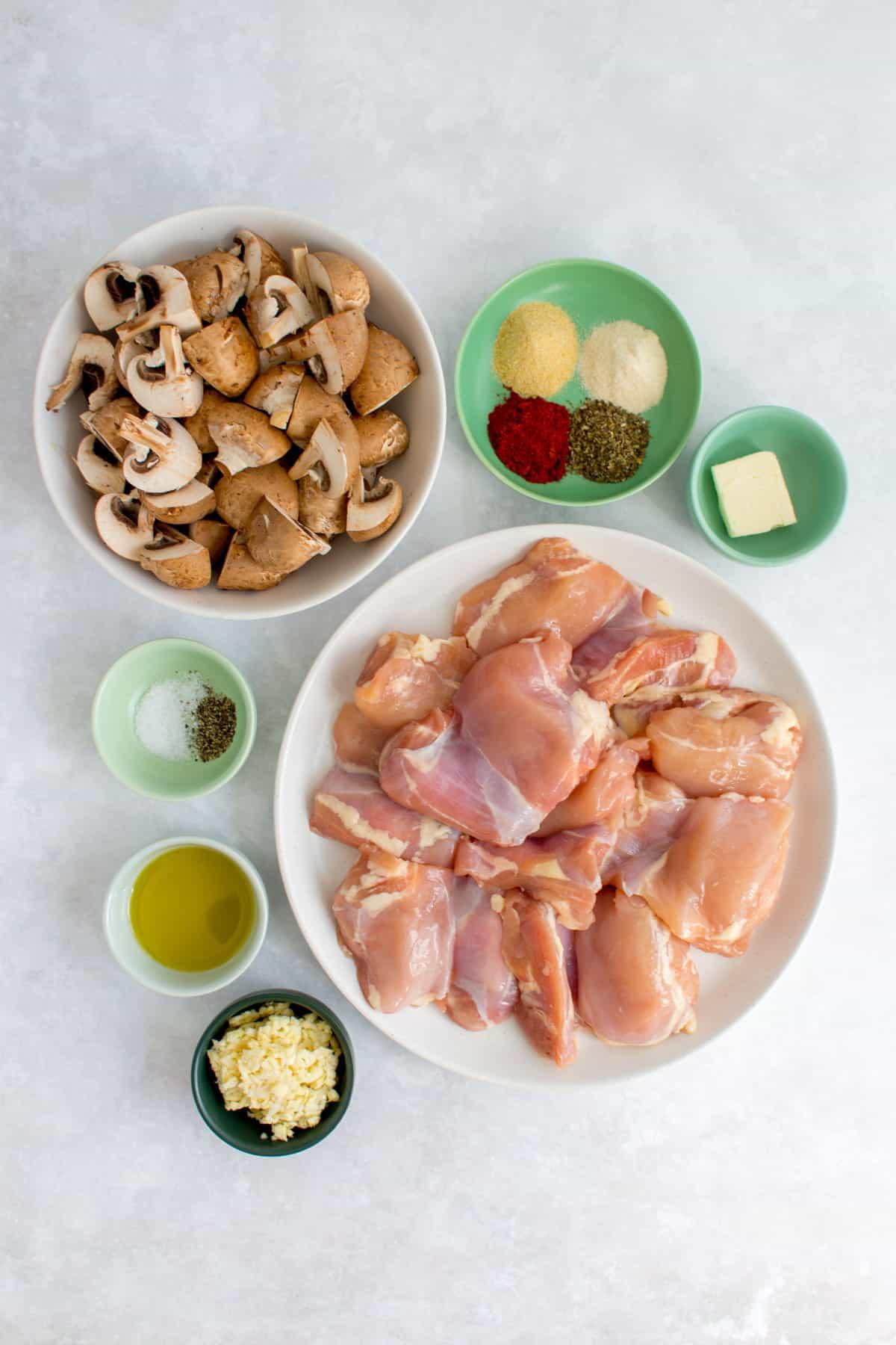 Ingredients needed to make chicken thighs with garlic mushrooms.