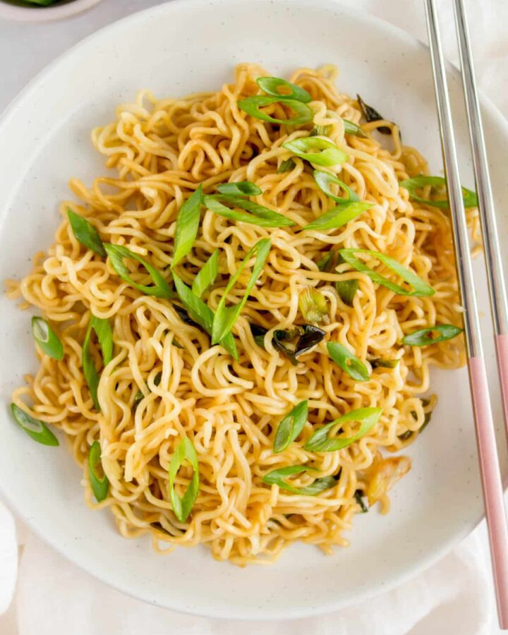 A plate of noodles tossed in garlic scallion oil.