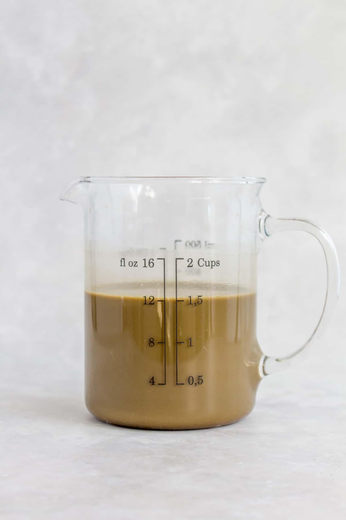 Hojicha mixture in a measuring cup.
