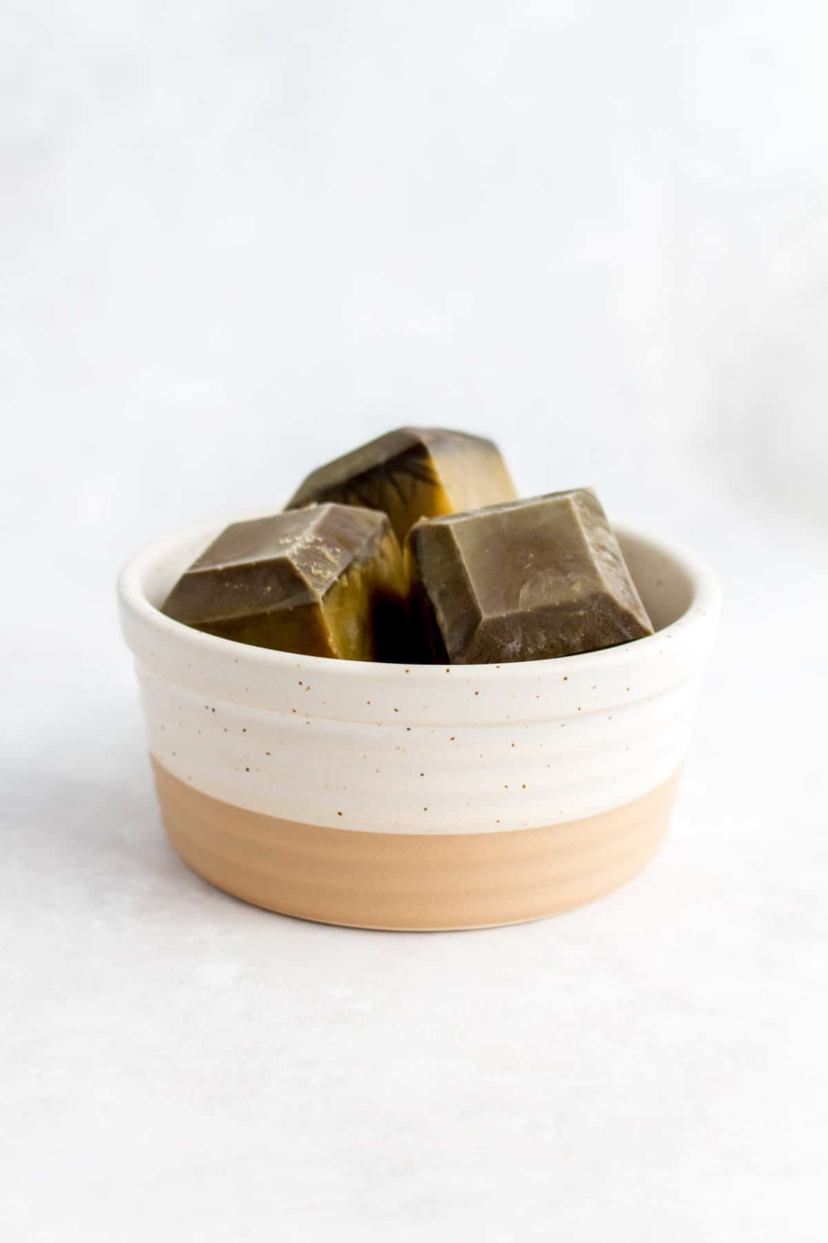 Hojicha ice cubes in a small container.
