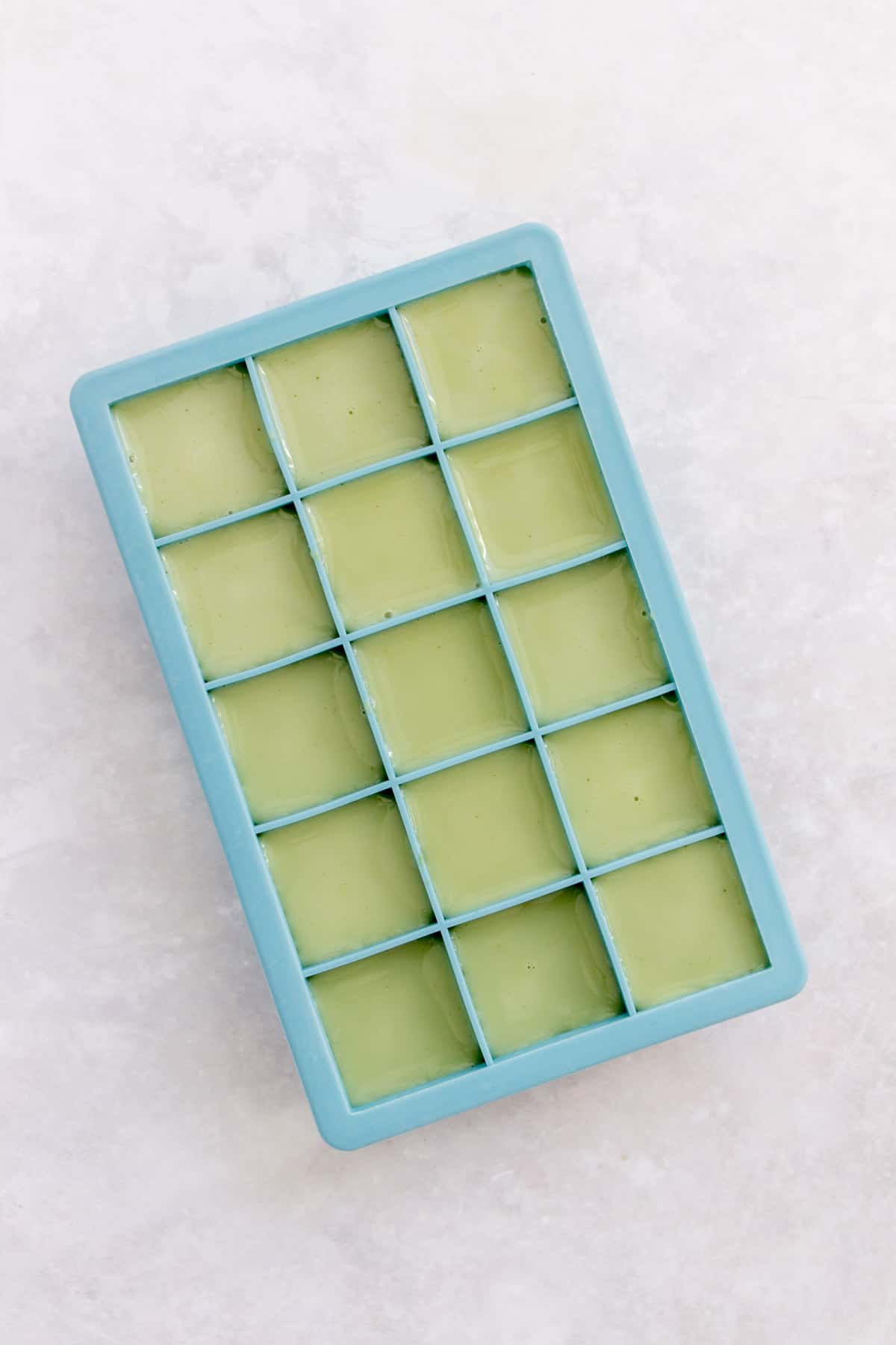 Matcha iced latte in an ice cube tray.