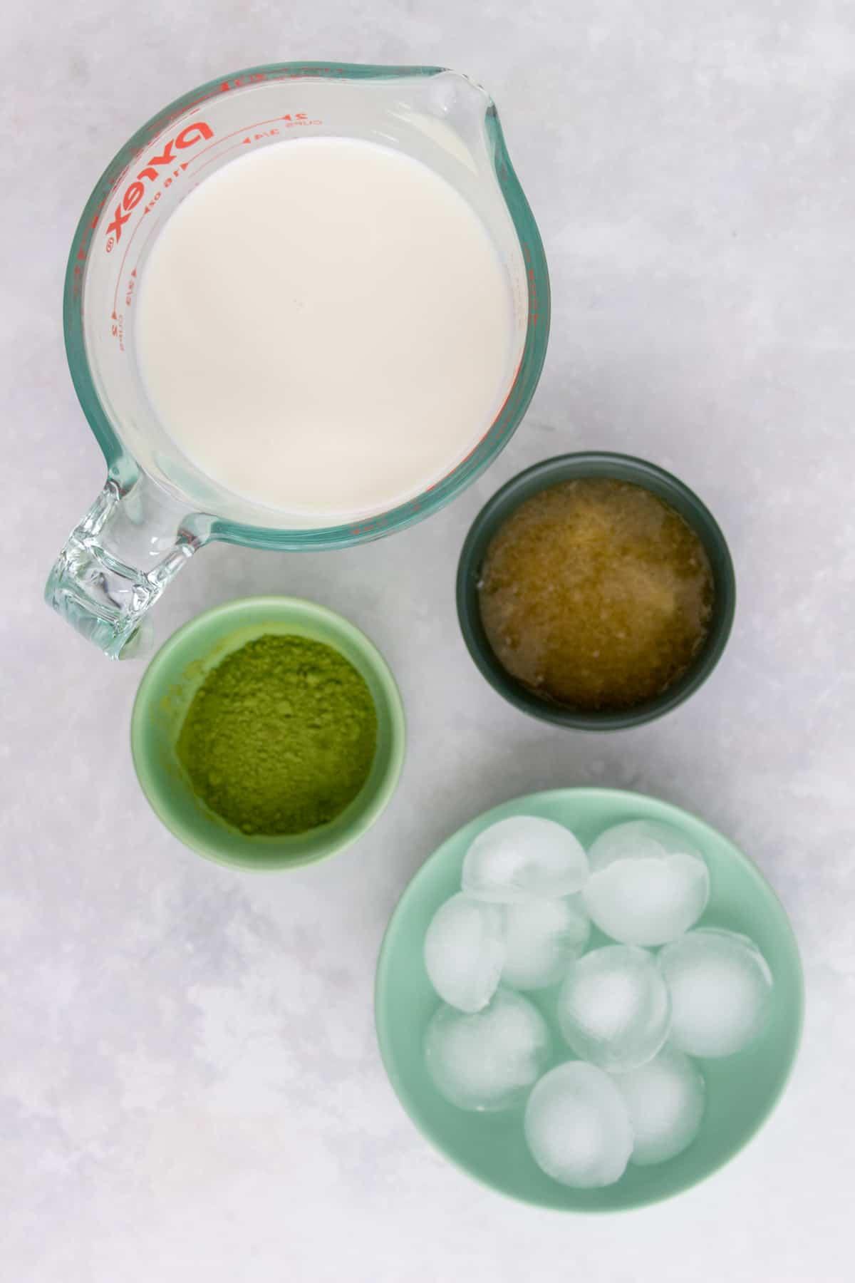 Ingredients needed to make matcha latte.