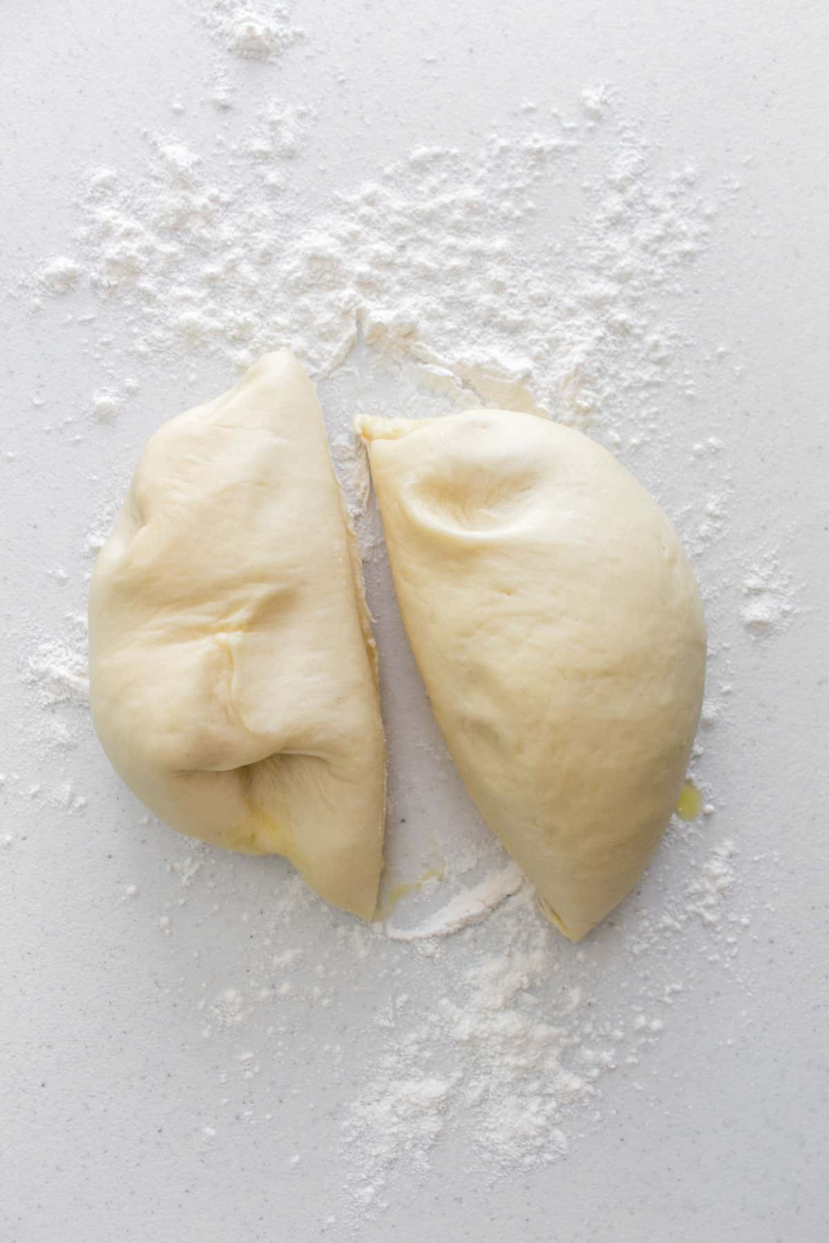 Milk bread dough cut in half.