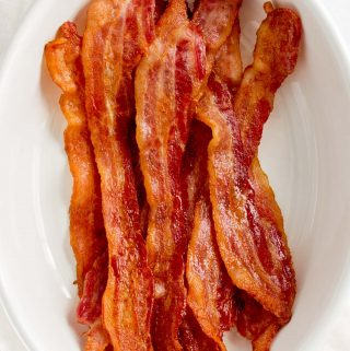 Close up of oven baked bacon in a serving platter.