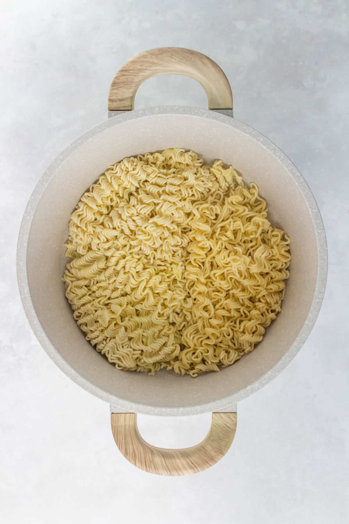 A pot of cooked noodles.