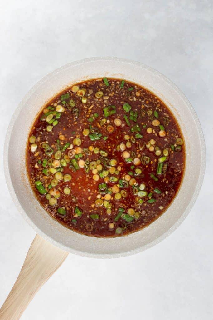 Sesame noodle sauce in a skillet.