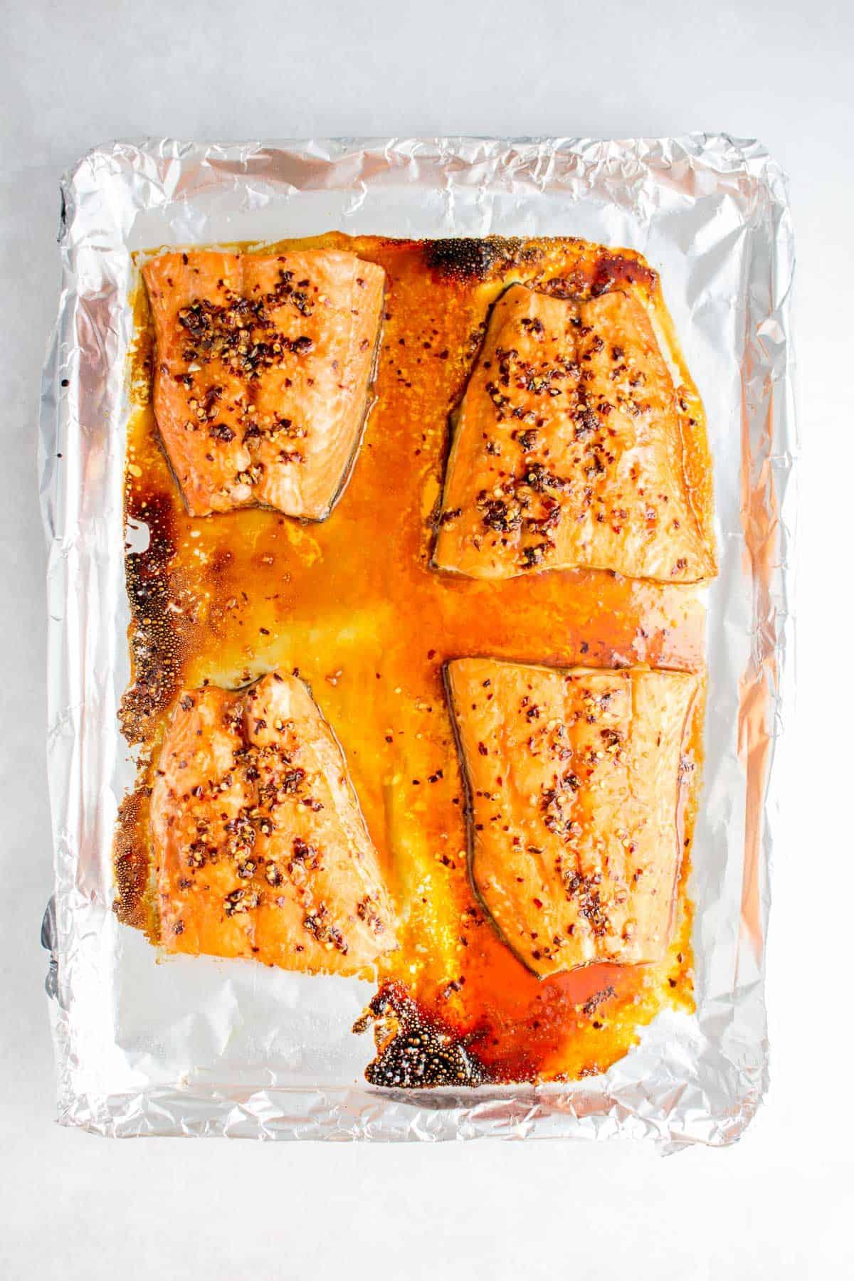 Baked sweet chili salmon on a sheet pan.