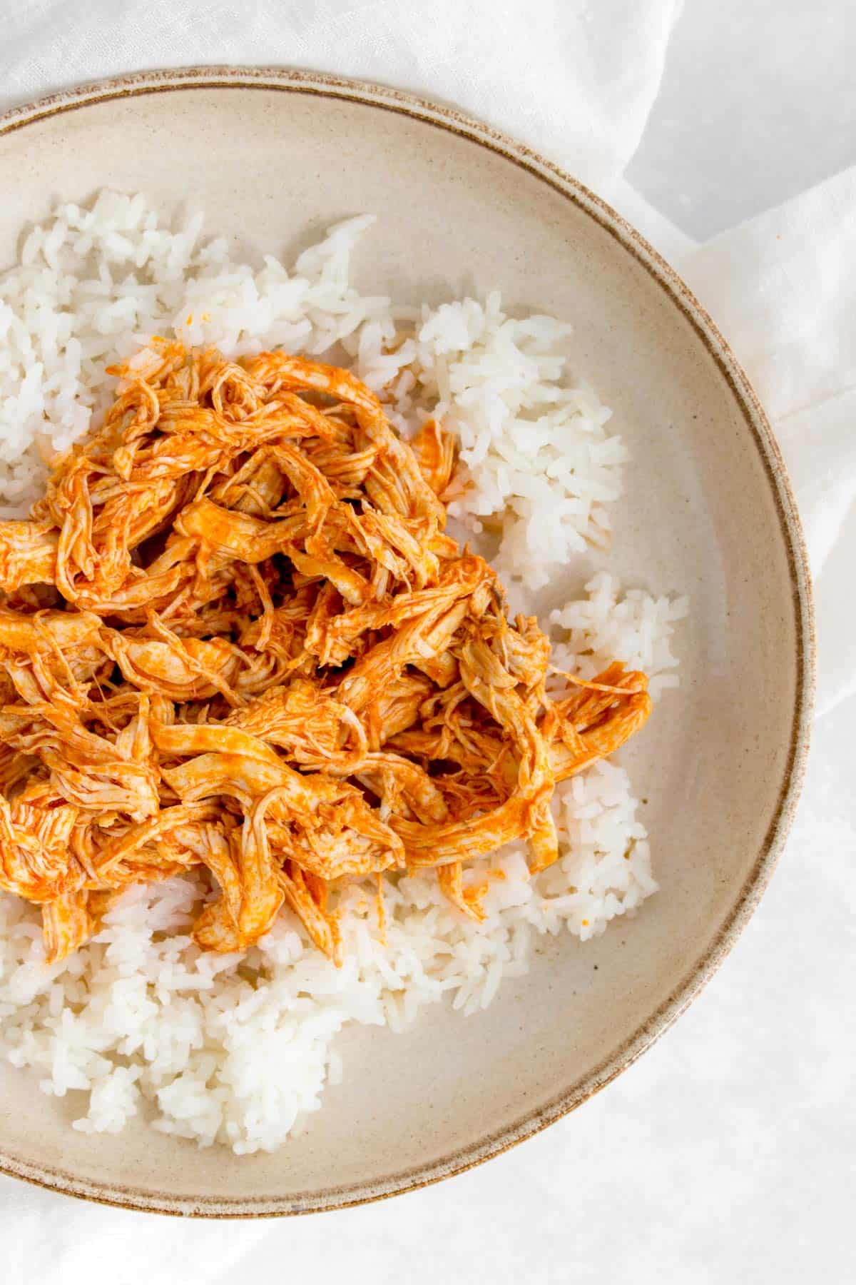 Shredded buffalo chicken over rice.