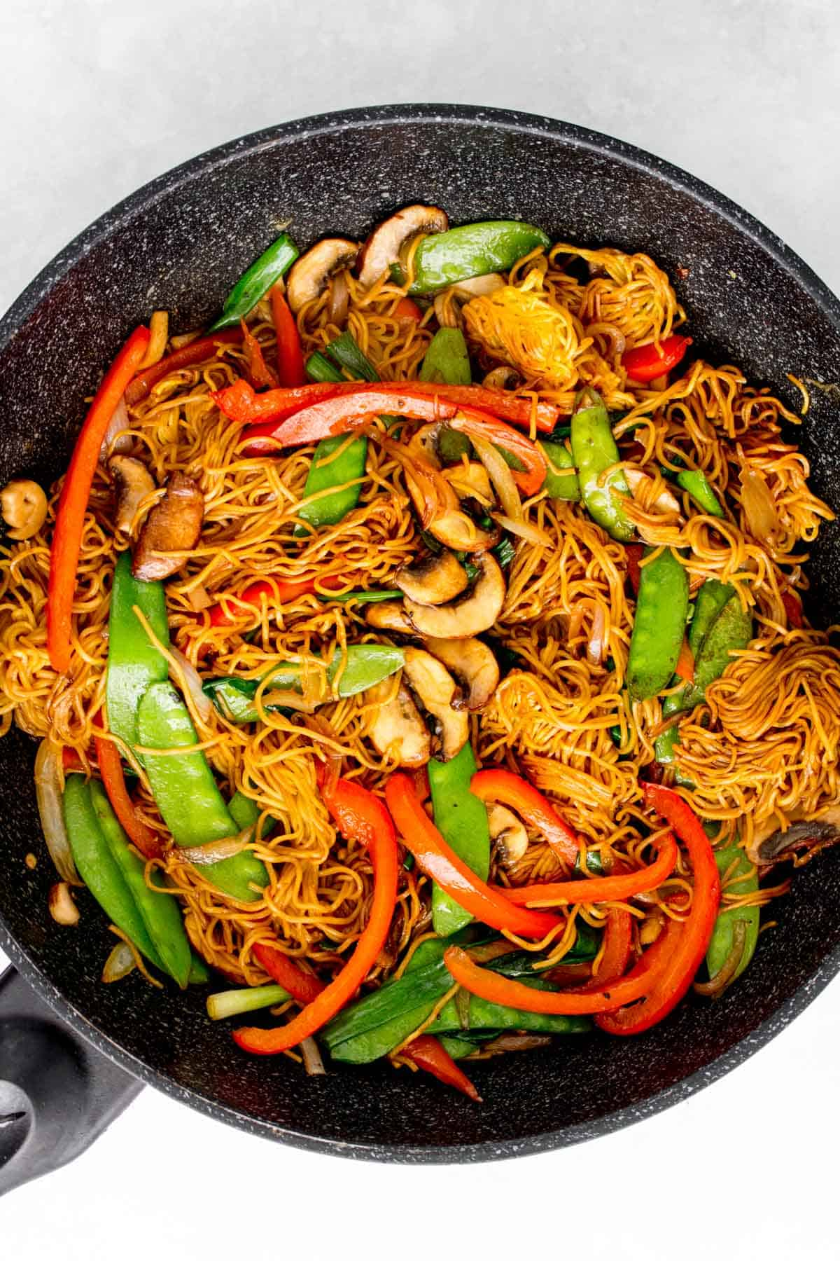 Soy sauce pan fried noodles with vegetables in a pan.