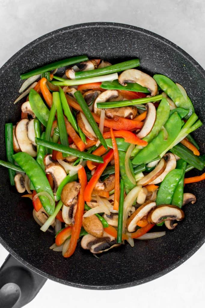 Mushrooms and green onions added to vegetable stir fry.