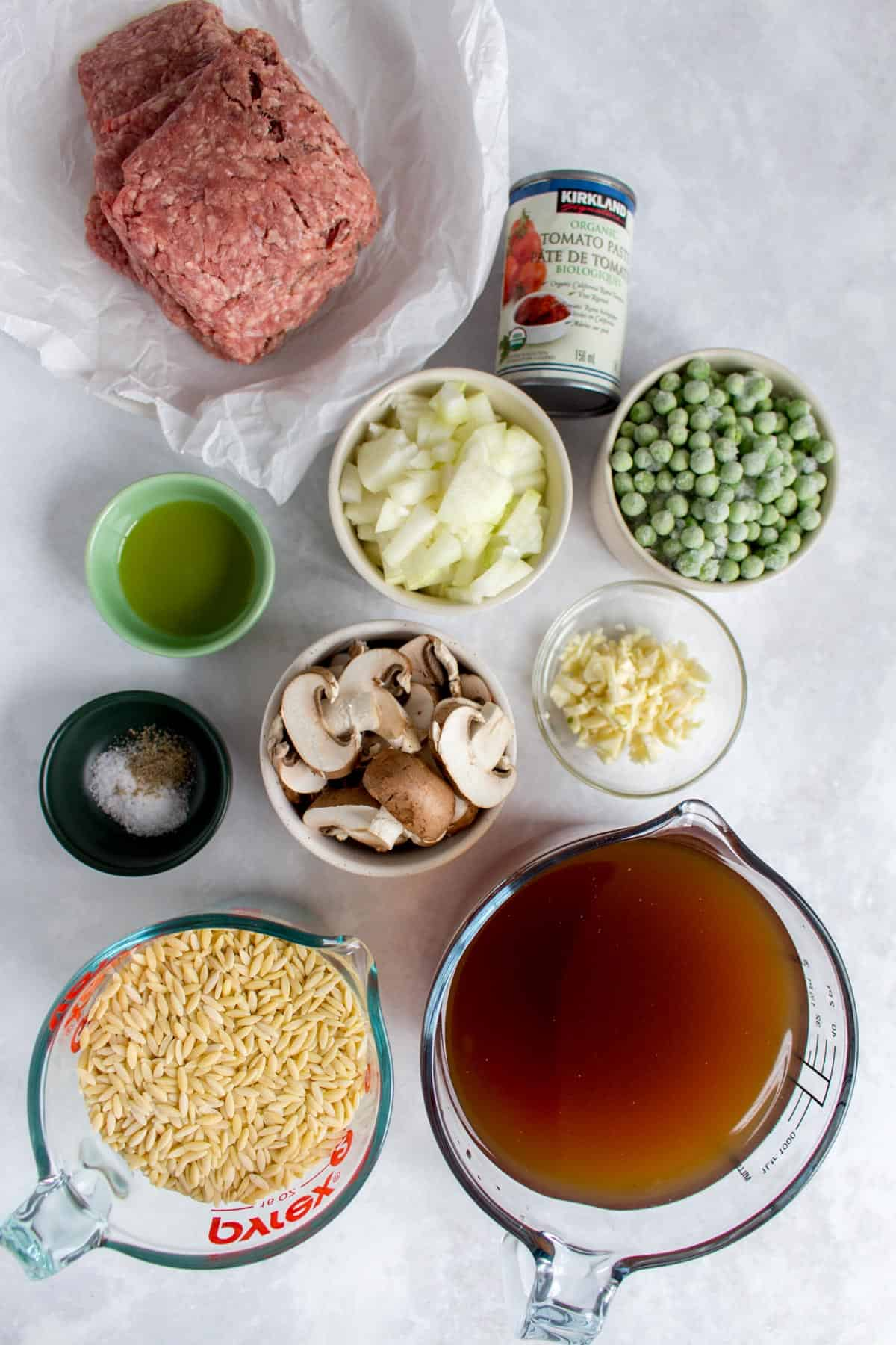 Ingredients needed to make orzo bolognese.