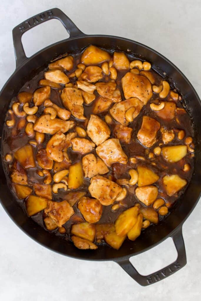 A Staub pan with pineapple chicken.