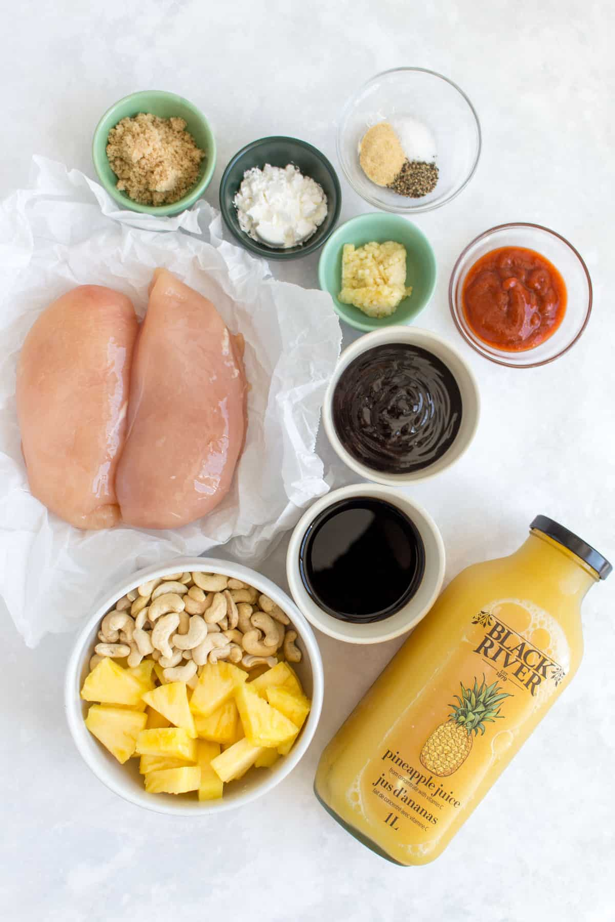 Ingredients needed to make spicy pineapple chicken.