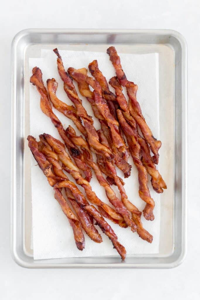 Twisted bacon on a paper towel lined sheet pan.