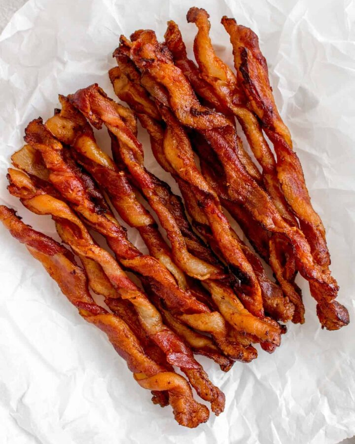Twisted bacon from Tik Tok on a parchment lined plate.