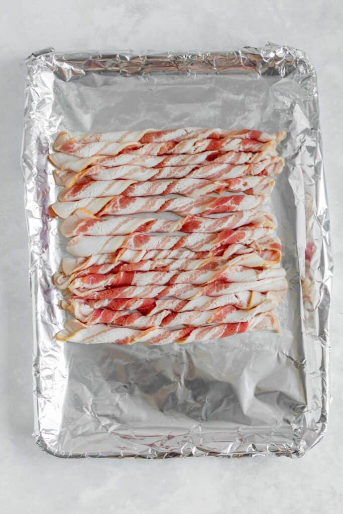 Twisted bacon on a sheet pan before baking.