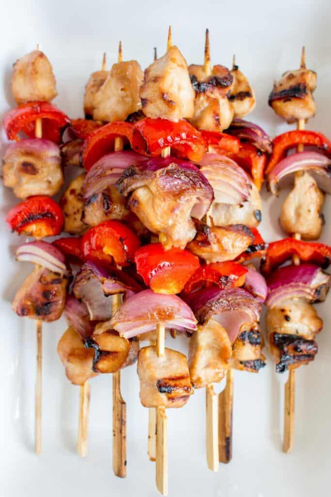 Honey garlic chicken skewers on a platter.