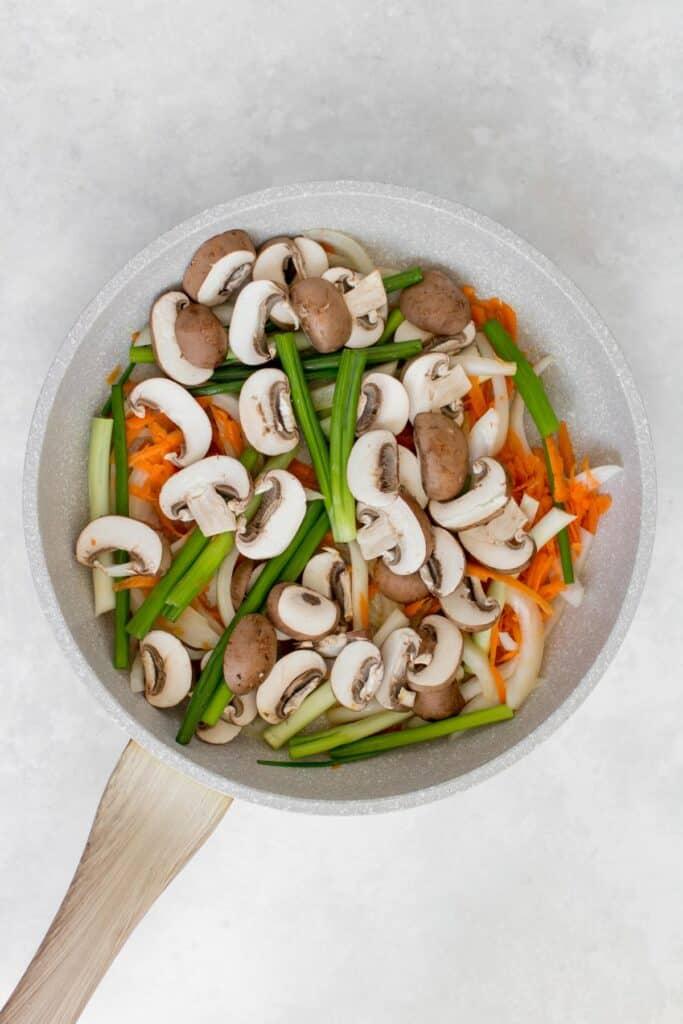 Vegetables in a skillet.