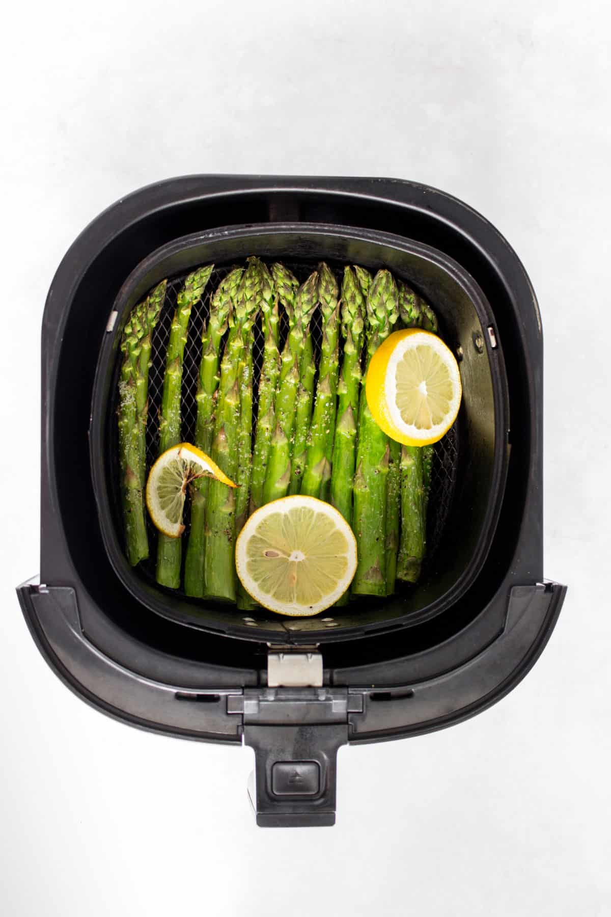 Air fried asparagus in the basket.