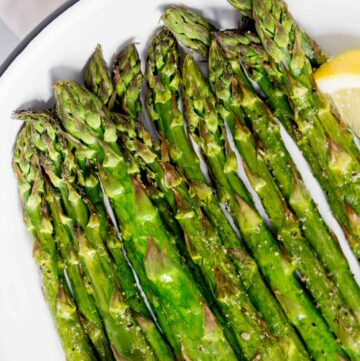 Close up of asparagus cooked in an air fryer.