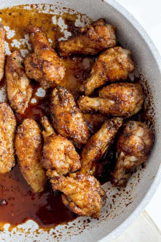 Crispy chicken wings coated in soy garlic glaze (dakgangjeong).