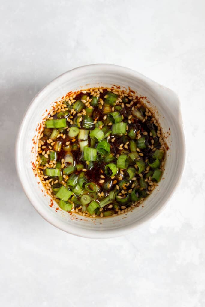 soy sesame sauce in a spouted bowl.