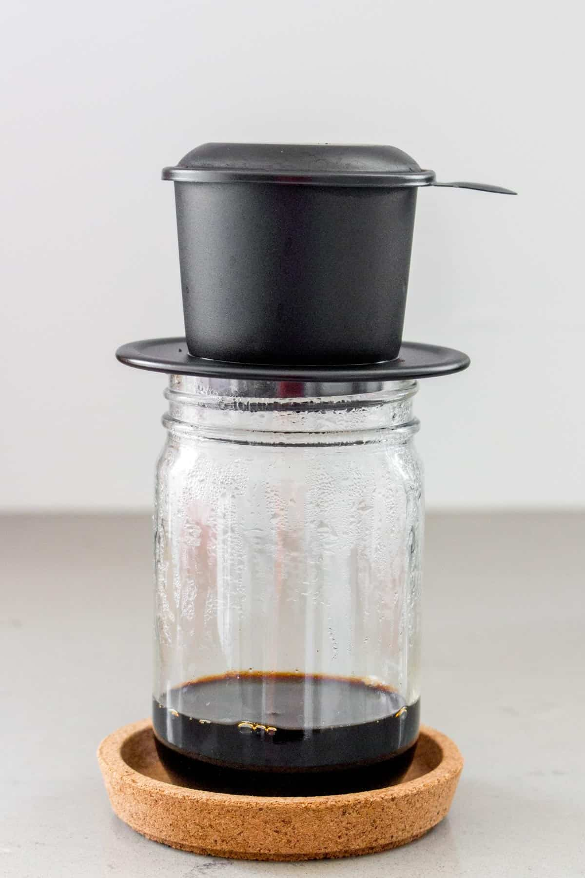 Vietnamese coffee phin over top of a mason jar.