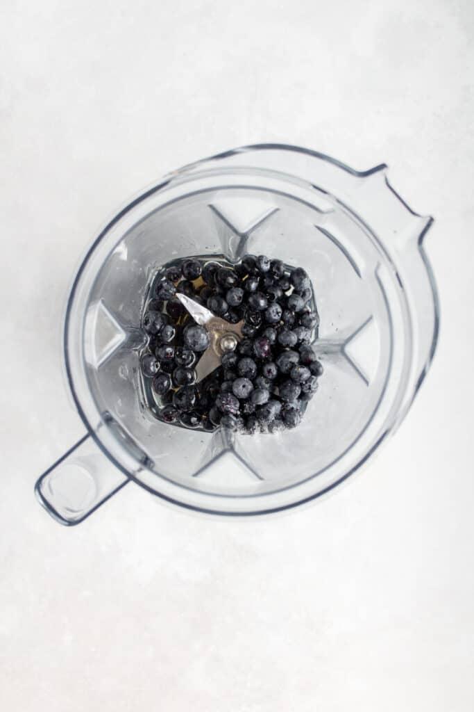 Blender with ingredients for blueberry vinaigrette.