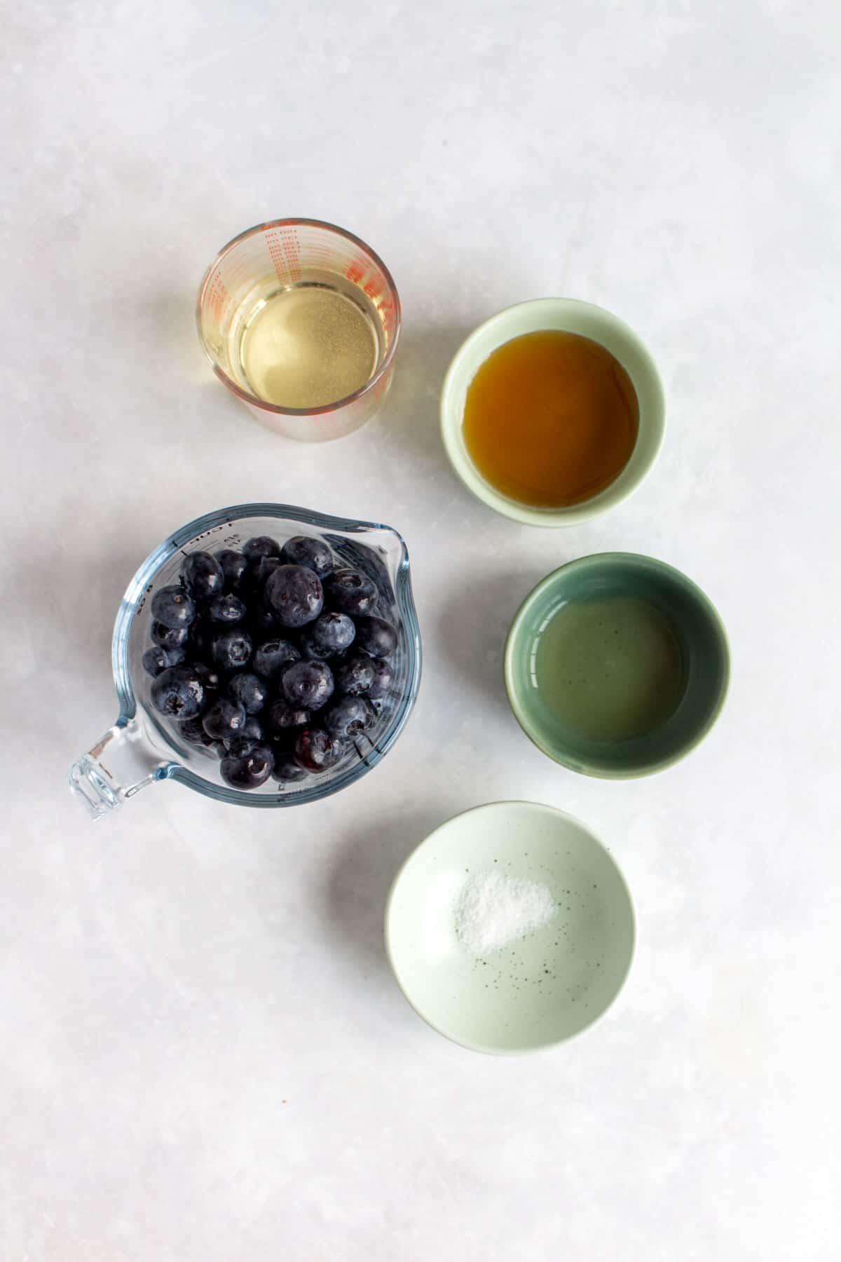 Ingredients needed to make blueberry vinaigrette.